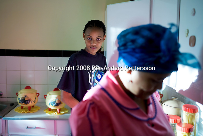 KOICHAS, NAMIBIA APRIL 3: Reliance Biwa, age 19, cooks with her mother Winnie in the kitchen in the family home on April 3, 2008 outside Koichas, Namibia. She finished high school last year and is waiting to go to Perth, Australia to study medicine. Her father, Gabriel Biwa has been one of the beneficiaries of recent land reform in Namibia, which gives land back to the black population. He is one of a very few successful black farmers in the country. (Photo by Per-Anders Pettersson/Getty Images).