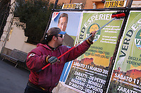 Giovani precari lavorano come attacchini durante la propaganda elettorale..Precarious young people while posting billboards during the election propaganda ....