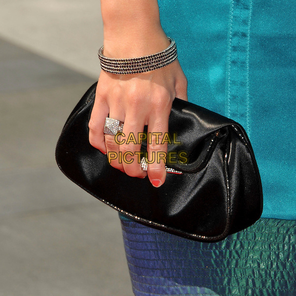 ASHLEY TISDALE's bag.61st Annual Creative Arts Emmy Awards held at Nokia Theatre LA Live, Los Angeles, California, USA, .12th September 2009..emmys detail black clutch bag ring bracelet hand .CAP/ADM/BP.©Byron Purvis/Admedia/Capital Pictures