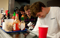 Sophomore Kyle Crymes (cq, right) and sophomore Fritz Blue (cq, right) tare first in line for dinner at the Sigma Alpha Epsilon fraternity house on the Southern Methodist University campus in Dallas, Texas, Friday, january 20, 2011. Some high-end chefs have found professional salvation from an unlikely location: Fraternity Row. ..Matt Nager for The Wall Street Journal..Matt Nager for The Wall Street Journal