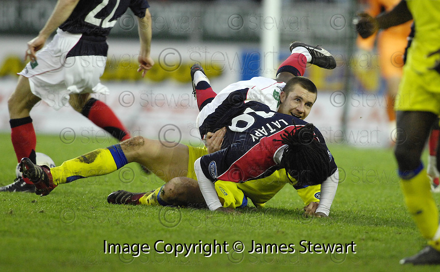 27/01/2007       Copyright Pic: James Stewart.File Name : sct_jspa10_falkirk_v_kilmarnock.COLIN NISH AND RUSSELL LATAPY GET CLOSE.....James Stewart Photo Agency 19 Carronlea Drive, Falkirk. FK2 8DN      Vat Reg No. 607 6932 25.Office     : +44 (0)1324 570906     .Mobile   : +44 (0)7721 416997.Fax         : +44 (0)1324 570906.E-mail  :  jim@jspa.co.uk.If you require further information then contact Jim Stewart on any of the numbers above.........