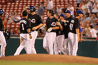 Buffalo Bisons Nick Evans is mobbed by teammates after hitting a walk off single during a game vs. the Lehigh Valley IronPigs at Coca-Cola Field in Buffalo, New York;  August 1, 2010.  Buffalo defeated Lehigh Valley 2-1 in 10 innings.  Photo By Mike Janes/Four Seam Images
