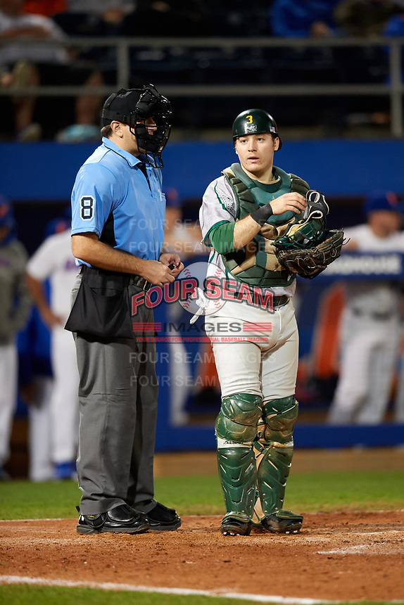 Siena Saints catcher Phil Madonna (3) looks to the dugout as umpire Josh Miller looks on during a game against the Florida Gators on February 16, 2018 at Alfred A. McKethan Stadium in Gainesville, Florida.  Florida defeated Siena 7-1.  (Mike Janes/Four Seam Images)