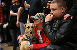 Veterans Sarah Goulart, her service dog Chaos, and Aaron Endel listen to speakers following the second annual Suicide Awareness March at Western Nevada College, in Carson City, Nev. on Saturday, May 7, 2016. The event raises awareness about the average 22 veteran suicides each day in the U.S. and the local services available to help. <br />