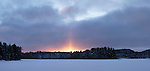 Covered with snow frozen lake sunset winter landscape panoramic nature scenery at Algonquin Provincial Park, Ontario, Canada