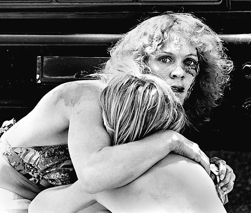 A wounded Diane Wick protects her nephew, Timmy Lapping during a sniper attack on San Antonio's Fiesta Parade in 1974.