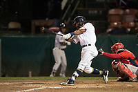 Helena Brewers center fielder Pablo Abreu (12) follows through on his swing in front of catcher Griffin Barnes (28) during a Pioneer League game against the Orem Owlz at Kindrick Legion Field on August 21, 2018 in Helena, Montana. The Orem Owlz defeated the Helena Brewers by a score of 6-0. (Zachary Lucy/Four Seam Images)