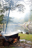 A roll top bath has been set up in a private spot on the edge of the lake for washing al fresco