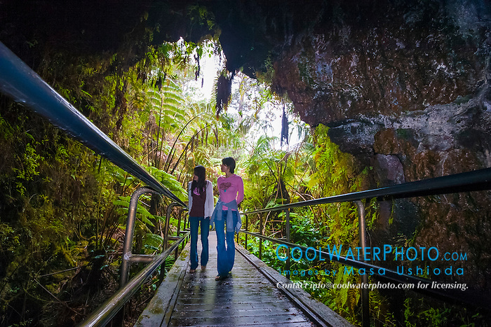 woman tourists, hiking rainforest trail, Nahuku - Thurston Lava Tube, Hawaii Volcanoes National Park, Kilauea, Big Island, Hawaii, USA, MR