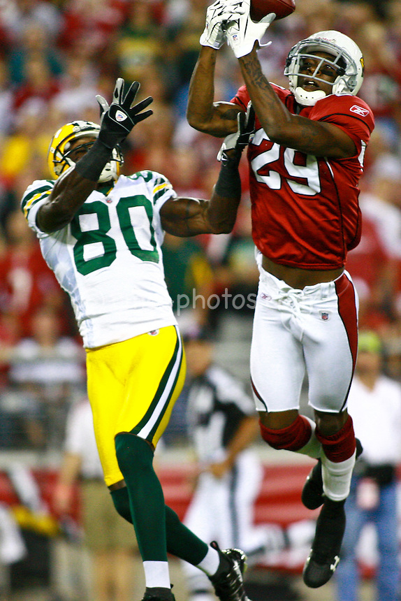 Aug 28, 2009; Glendale, AZ, USA; Arizona Cardinals cornerback Dominique Rodgers-Cromartie (29) breaks up a pass intended for Green Bay Packers wide receiver Donald Driver (80) during the 1st quarter of a preseason game at University of Phoenix Stadium.