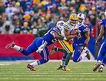 14 December 2014: Green Bay Packers wide receiver Randall Cobb finds a lane for a 3-yard gain in the fourth quarter against the Buffalo Bills at Ralph Wilson Stadium in Orchard Park, NY. The Bills defeated the Packers 21-13, snapping the Packers' 5-game winning streak and keeping the Bills' 2014 playoff hopes alive. Mandatory Credit: Ed Wolfstein Photo *** RAW (NEF) Image File Available ***