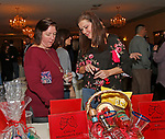 Torrington, CT 011318MK02  (from left) Dawn Dell'Agnese and Adriana Costabrown along with of a sold out crowd of hundreds look over items during the silent auction at the Torrington D.A.R.E.'s  2nd annual fundraiser at Chatterley's in Torrington Saturday night.  Jennifer Lopez event coordinator said that the proceeds will benefit the program.   Torrington Police Department's Sargent Richard Dowd along with Officer Michael Gallagher and Capt. Louis Gonzalez  engage all Torrington fifth grade students in a ten week program that provides education about the challenges of drugs, alcohol, bullying and cyber intimidations.  Students are then challenged to read and then write about what they have learned. Michael Kabelka / Republican-American