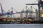 Containers and cranes in the port harbour. Hamburg, Germany.