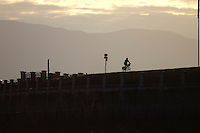 Lone Cyclist silhouetted in Stanley Park,Vancouver, Canada