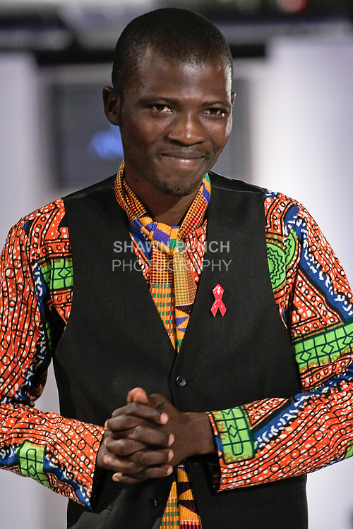 Ghanaian fashion designer Felix Anaman, walks the runway at the close of his Felix Anaman Clothing collection, during BK Fashion Weekend Spring Summer 2012.