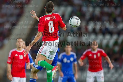 Hungary's Adam Pinter (C) jumps for a header during a friendly football match Hungary playing against Israel in Budapest, Hungary on August 15, 2012. ATTILA VOLGYI