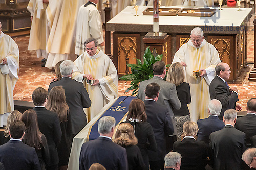 "Mar. 4, 2015; University of Notre Dame President Rev. John Jenkins, C.S.C. and President Emeritus Rev. Edward ""Monk"" Malloy distribute Holy Communion at the funeral Mass for President Emeritus Rev. Theodore M. Hesburgh, C.S.C. (Photo by Matt Cashore/University of Notre Dame)"