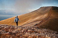 Female hiker with Corn Du in Background, Brecon Beacons national park, Wales