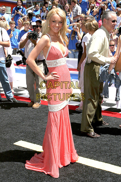 "LINDSAY LOHAN.World Premiere of ""Herbie Fully Loaded"" held at the .El Capitan Theatre, Hollywood, CA, USA,.19 June 2005..full length orange red patterned printed polka dot dots  dress white stripes straps lace hand on hip.Ref: ADM.www.capitalpictures.com.sales@capitalpictures.com.©Jacqui Wong/AdMedia/Capital Pictures."