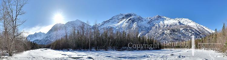 The sun clears the mountains overlooking Rapids Camp on the Eagle River north of Anchorage, Alaska, as winter begins to lose its grip on the countryside.