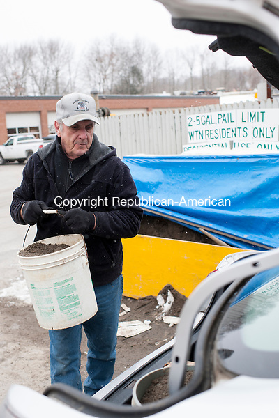 WATERTOWN, CT-26 January 2015-012615EC01-  Charles Stockwell of Watertown loads up buckets filled with sand offered by the Department of Public Works on Burton Street. Besides getting supplies Monday morning, Stockwell says he planned to stay home to ride out the storm. Erin Covey Republican-American