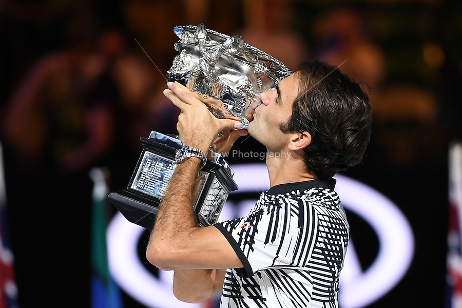 January 29, 2017: Roger Federer of Switzerland kisses the trophy after winning the Men's Final against Rafael Nadal of Spain on day 14 of the 2017 Australian Open Grand Slam tennis tournament in Melbourne, Australia. Photo Sydney Low