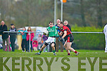 Cathal Moriarty Milltown/Castlemaine receives the ball with his back turned to goal