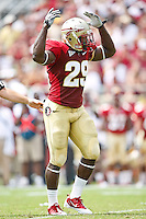 September 04, 2010:    Florida State Seminoles linebacker Kendall Smith (29) urges the crowd to cheer during first half action between the Florida State Seminoles and the Samford Bulldogs at Doak Campbell Stadium in Tallahassee, Florida.  Florida State defeated Samford 59-6.
