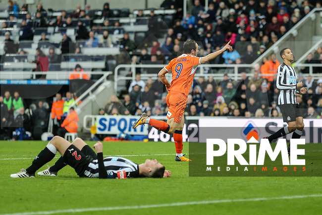 Danny Hylton of Luton Town (centre) celebrates after he scores his team's first goal of the game to make the score 3-1 during the FA Cup 3rd round match between Newcastle United and Luton Town at St. James's Park, Newcastle, England on 6 January 2018. Photo by David Horn.