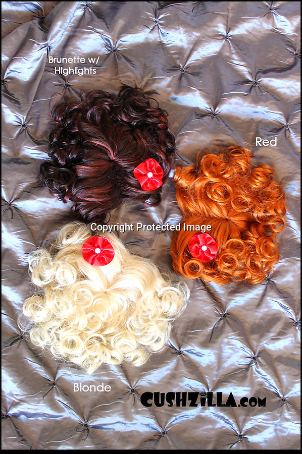 BNPS.co.uk (01202 558833)<br /> Pic: Cushzilla/BNPS<br /> <br /> ***Please use full byline***<br /> <br /> Marilyn wigs.<br /> <br /> A barking-mad designer has launched a range of wigs that turn pets into pop princesses including Katy Perry, Lady Gaga, Britney Spears and even Dolly Parton.<br /> <br /> Dogs and cats can also be dressed up as dragons, pilots, wizards or Prince Charming thanks to Leah Workman's wacky creations.<br /> <br /> The 40-year-old from Los Angeles spotted the trend of dressing up pets while studying in Japan - and later teamed up with husband Hiroshi Hibino to launch company Cushzilla.<br /> <br /> The pair instantly set tails wagging around the internet with their bonkers brand of pet fashion, which also features Sharon Osbourne and Sid Vicious wigs and cow and tiger costumes.<br /> <br /> Leah imports the high quality handmade wigs while costumes come from famous Japanese pet clothing designer Takako Iwasa.<br /> <br /> She says the most popular wig is the Lady Gaga, while the pilot's outfit tops the popularity charts in the costume department.<br /> <br /> Her own cats Jitters and Justus model many of the products on the company's website.
