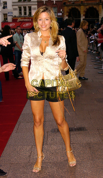 """REBECCA LOOS.""""You, Me & Dupree"""" UK film premiere, Odeon, Leicester Square, London, UK..August 22nd, 2006.Ref: CAN.full length black shorts gold purse bag jacket cream.www.capitalpictures.com.sales@capitalpictures.com.©Can Nguyen/Capital Pictures"""