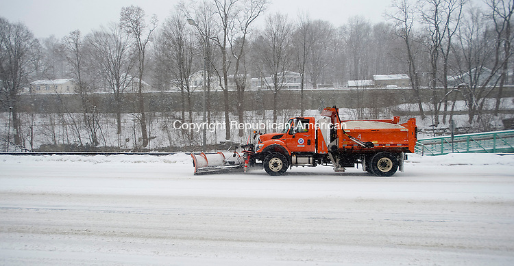 WINSTED, CT-021314JS04- A D.O.T. plow clears a portion of Main Street in Winsted on Thursday as the snow begins to fall from the latest snowstorm. All the state plows as well as private contractors will be on the roads to clear the snow as it falls.  <br /> Jim Shannon Republican-American