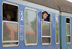A refugee child looks out the window of a train as it pulls into the Hungarian town of Hegyeshalom. Migrants and refugees aboard the train walk from here across the border into Austria. Hundreds of thousands of refugees and migrants flowed through Hungary in 2015, on their way to western Europe from Syria, Iraq and other countries.