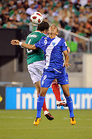 Wilfred Velasquez (9) of Guatemala and Gerardo Torrado (6) of Mexico go up for a header. Mexico defeated Guatemala 2-1 during a quarterfinal match of the 2011 CONCACAF Gold Cup at the New Meadowlands Stadium in East Rutherford, NJ, on June 18, 2011.