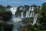 The powerful San Martin Waterfall at left with Mbigua Falls at right in Iguazu Falls National Park in Argentina.   A UNESCO World Heritage Site.