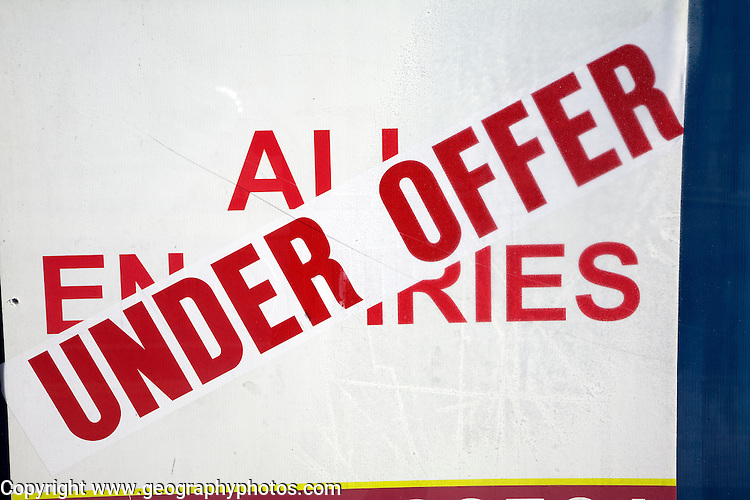 Sign showing property 'under offer' on top of 'all enquiries'