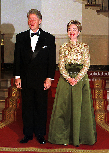 United States President Bill Clinton and first lady Hillary Rodham Clinton prepare to greet guests at the 1999 National of Arts and Humanities Dinner at the White House in Washington, DC on September 29, 1999..Credit: Ron Sachs / CNP