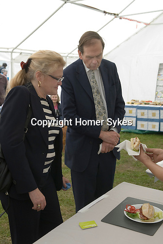 Conservative MP Laura Sandys and The Earl of Sandwich . John the 11th Earl of Sandwich tasting a sandwich competition on the occasion of the 250 anniversary of the sandwich. Sandwitch Kent. UK