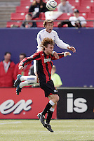The EarthQuakes' Eddie Robinson goes up for a header over Eddie Gaven of the MetroStars. The San Jose EarthQuakes defeated the MetroStars 1 - 0 at Giant's Stadium, East Rutherford, NJ, on Saturday May 7, 2005.