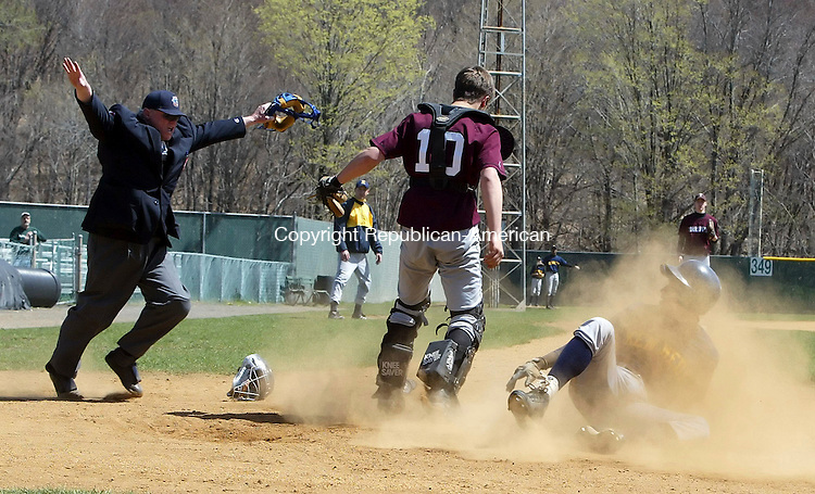 WATERBURY, CT-21 April 2006-042106TK05- (left to right:) Umpire Jim Shove calls a sliding Nick Batista of Kennedy High safe on a close play at the plate as Torrington High School catcher Greg Bodnar looks on.  Tom Kabelka Republican-American