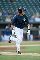 Catcher Juan Uriarte (17) of the Columbia Fireflies runs out a batted ball in a game against the Augusta GreenJackets on Saturday, June 1, 2019, at Segra Park in Columbia, South Carolina. Columbia won, 3-2. (Tom Priddy/Four Seam Images)