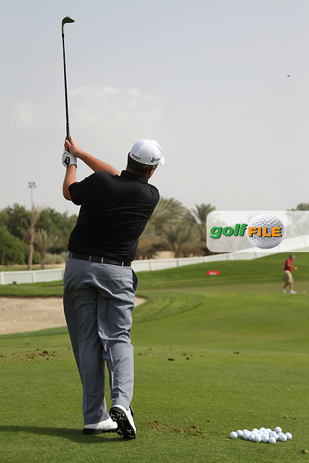 Shane Lowry Chipping during the Abu Dhabi HSBC Golf Championship 2013.Picture: Fran Caffrey / www.golffile.ie ..