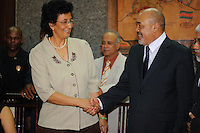 Jennifer Geerlings-Simons (L) the chairwoman of De Nationale Assemblée (DNA) / The National Assemble of Suriname congratulates The President of Suriname Desi Bouterse (Desiré Delano Bouterse) (R)  first time.....Desi Bouterse (Desiré Delano Bouterse) chosen as new president of Suriname by De Nationale Assemblée (DNA) / The National Assemble of Suriname. He took 36 votes of 51 as leader of the Mega Combination. ....Robert_Ameerali the head of KKF (Kamer van Koophandel en Fabrieken) / Chamber of Commerce and Industry also selected as Vice President.....Desi Bouterse (Desiré Delano Bouterse) will sworn at 3 August 2010