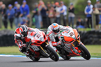 PHILLIP ISLAND, 27 FEBRUARY - Leon Camier (GBR) riding the Aprilia RSV4 (2) of the Aprilia Alitalia Racing Team and Joshua Waters (AUS) riding the Suzuki GSX-R1000 (12) of the YOSHIMURA SUZUKI Racing Team dicing for position during race one of round one of the 2011 FIM Superbike World Championship at Phillip Island, Australia. (Photo Sydney Low / syd-low.com)
