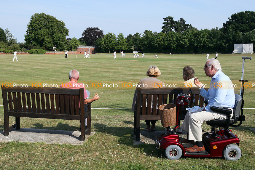 General view as a spectators watch play at Coggeshall cricket club - Essex CCC 2nd XI vs Surrey CCC 2nd XI - Second XI Championship Cricket at Coggeshall Cricket Club - 14/06/11 - MANDATORY CREDIT: Gavin Ellis/TGSPHOTO - Self billing applies where appropriate - Tel: 0845 094 6026