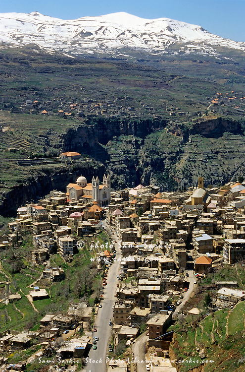 Bsharri village with view of snowcapped Lebanese Mountains, Lebanon.