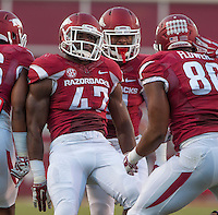 STAFF PHOTO ANTHONY REYES &bull; @NWATONYR<br /> Arkansas linebacker Martrell Spaight (47) celebrates a defensive stop with Trey Flowers (86) and other teammates against Northern Illinois University in the first quarter Saturday, Sept. 20, 2014 at Razorback Stadium in Fayetteville.