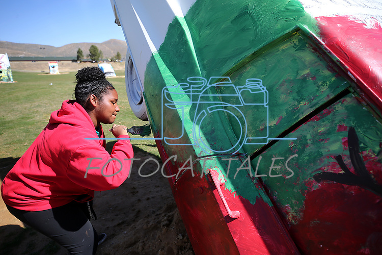 Doral Red Rock Academy student Kassidy Mays, 15, paints a Cadillac at the driving range at the Silver Oak Golf Course, in Carson City, Nev., on Sunday, April 8, 2018. The Las Vegas art students' work was a Carson City history theme. <br /> Photo by Cathleen Allison/Nevada Momentum