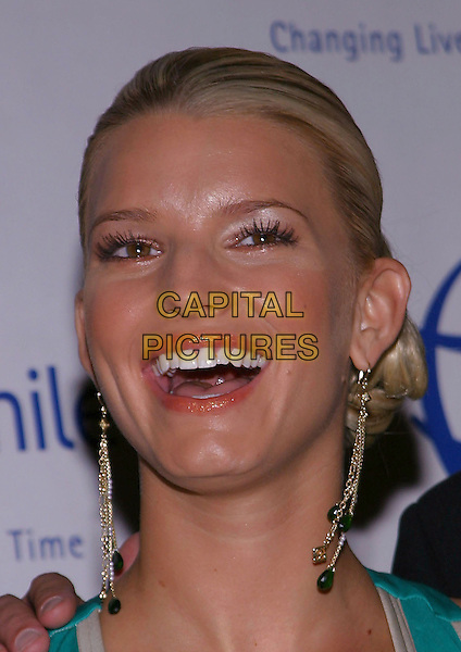 JESSICA SIMPSON.Operation Smiles - 3rd Annual Los Angeles Gala held at the Beverly Hilton Hotel. .21 September, 2004.headshot, portrait, dangling earrings, laughing, smiling.www.capitalpictures.com.sales@capitalpictures.com.© Jacqui Wong/AdMedia/Capital Pictures.