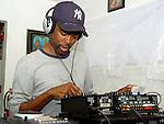 Actor/Comedian Chris Rock checks out DJ equipment of  Hurricane Katrina evacuee Ronald Williams while on a visit to the Bonita House in Houston,Texas Thursday Sept. 29,2005.